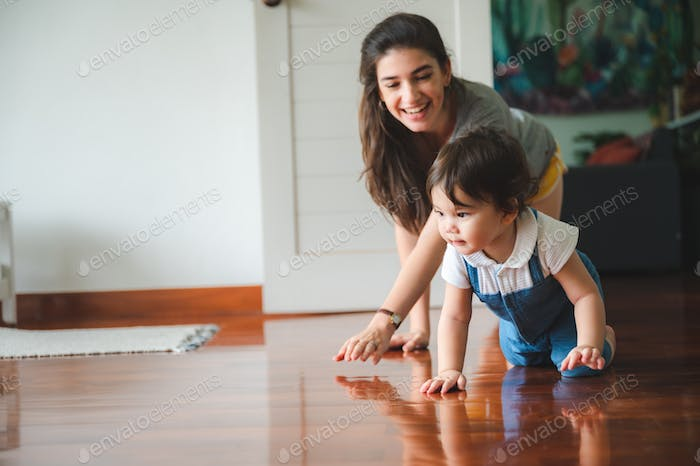 young mother happy to raising little children at home, woman family with newborn baby
