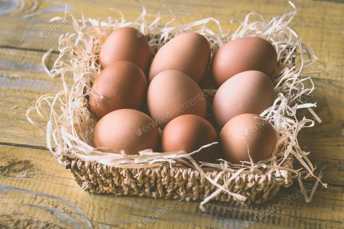 Basket of raw chicken eggs