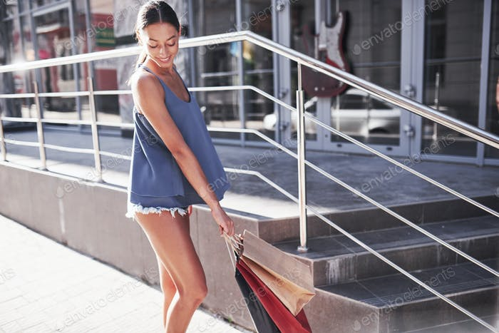 Attractive cute girl in with the bags enjoying in shopping. Favorite activity of all women