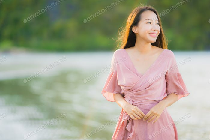 Portrait beautiful young asian woman smile happy walk on the tro
