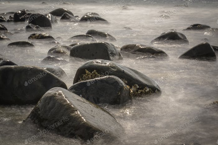 Rocky Stones in Blurred Water by Long Exposure