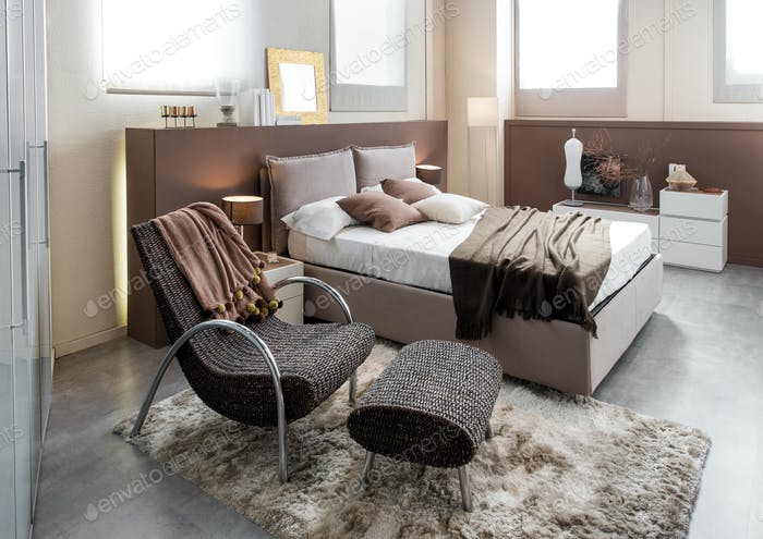 Modern luxury bedroom with recliner chair