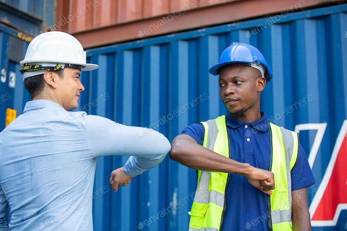 Construction worker elbow bump greeting with engineer foreman