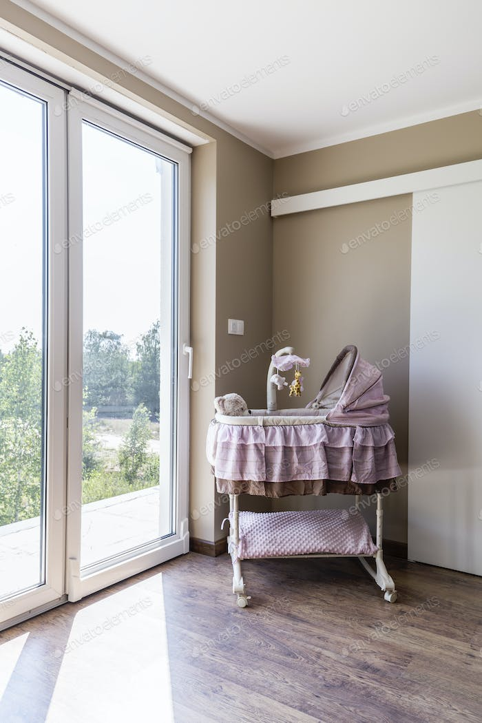 Bright nursery with adorable girly cradle