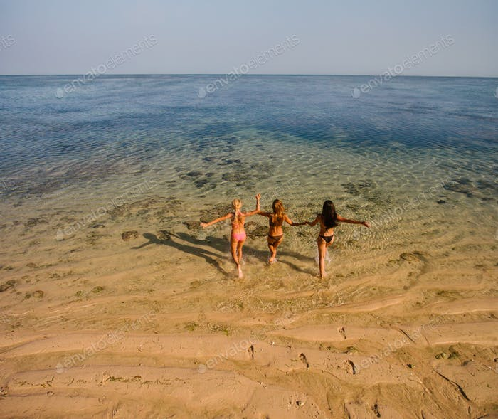 Female friends having fun on beach vacation