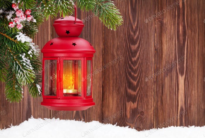 Christmas candle lantern on fir tree branch