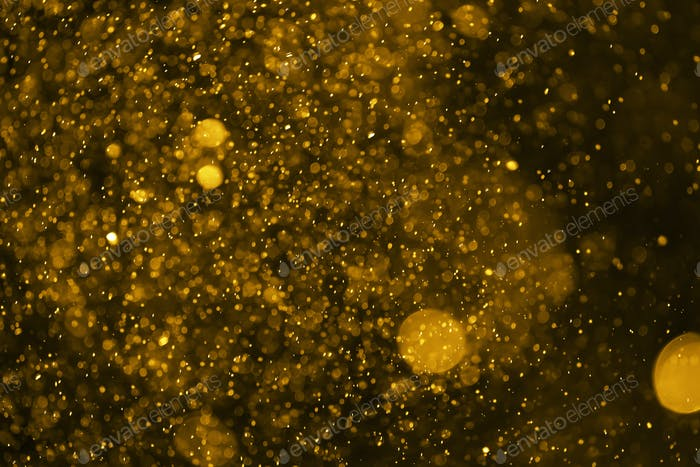 Abstract blur gold sparkle bokeh background
