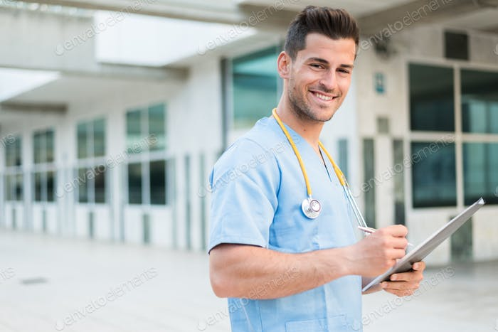 male nurse vet with stethoscope  and tablet