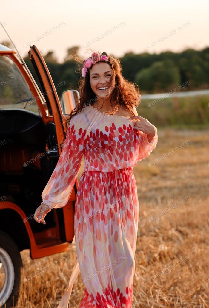 Beautiful hippie girl near van