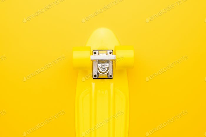 Skateboard on Yellow Background