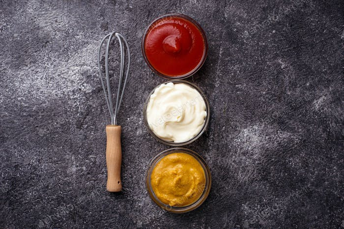 Set of different sauces: mustard, ketchup, mayonnaise.