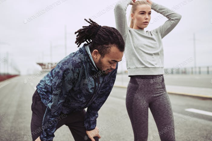 Young couple catching their breath after a run