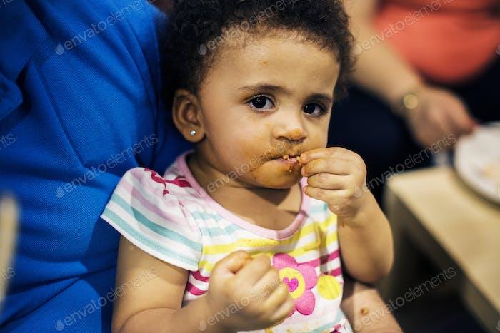 Brazilian toddler girl eating