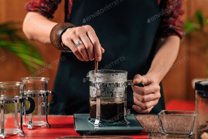 Barista  Making French Press Coffee