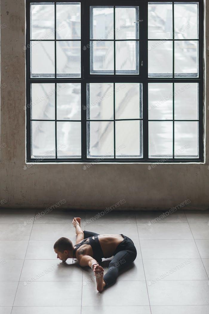 sporty female doing yoga stretching exercise - Upavistha Konasana