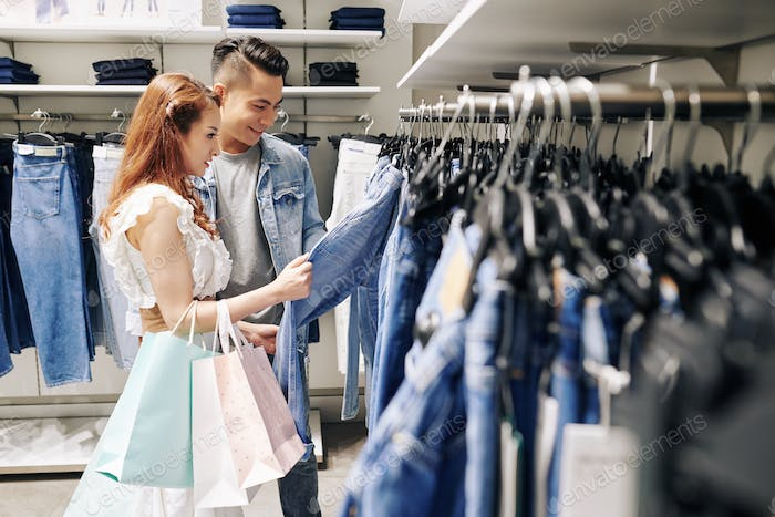 Couple buying jeans