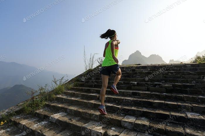 Running upstairs to mountain top