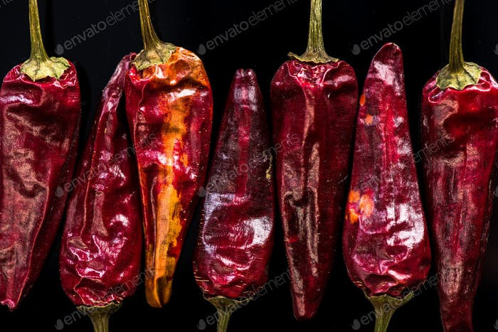 Dried red peppers macro shoot on dark