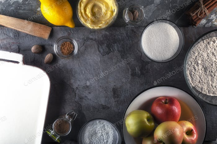 Frame of utensils, apples and lemon for cooking American apple pie