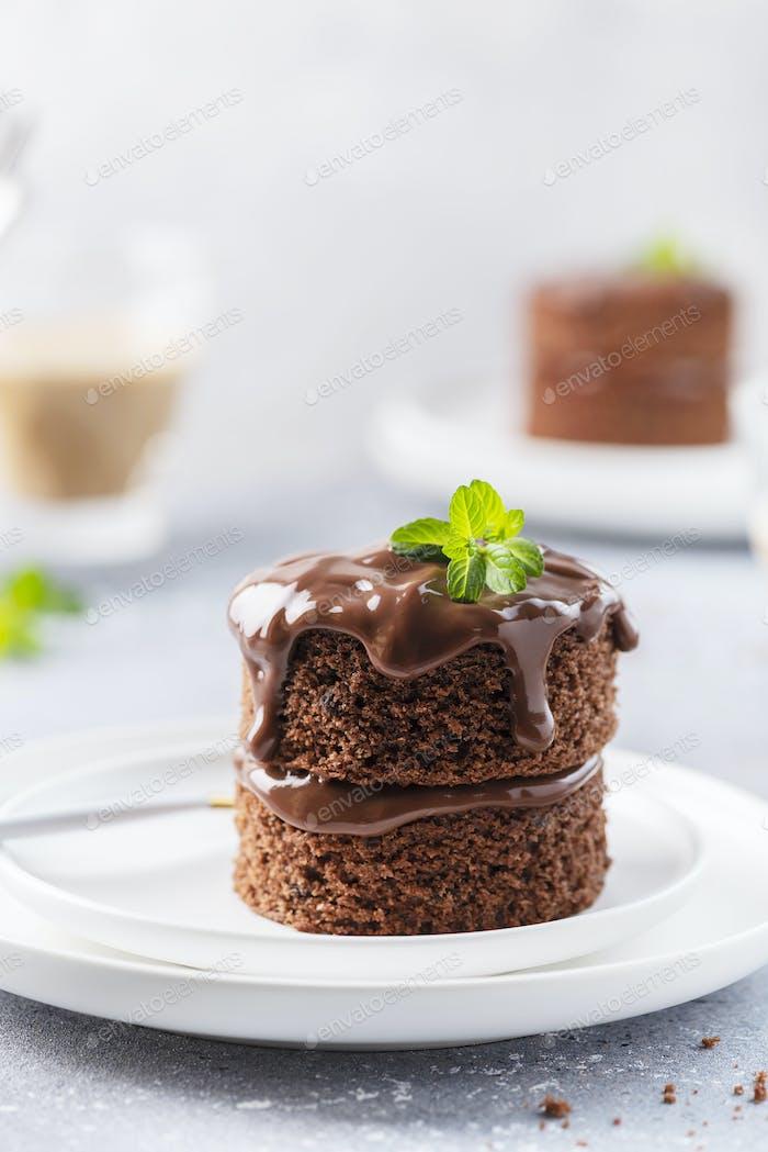 Chocolate mini cake with chocolate ganash and mint