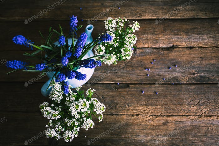 White and blue flowers on the old wooden background