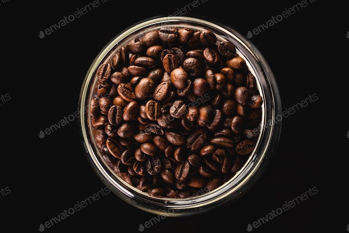a big jar full of coffee beans, isolated on black with clipping path