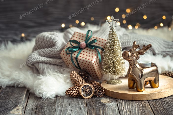 Christmas festive background with toy deer with a gift box and Christmas tree