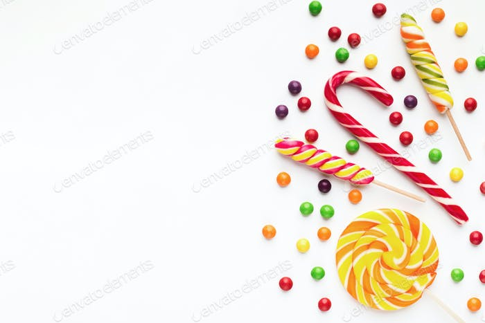 Colorful holiday background with candies and bonbons