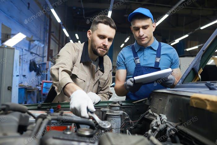 Caucasian Men Working In Auto Service
