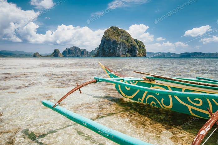 El Nido, Palawan, Philippines. local fishing boat surrounded by beautiful tropical landscape