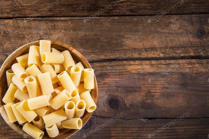 Raw Pasta  Mezzi Rigatoni in Wooden Bowl