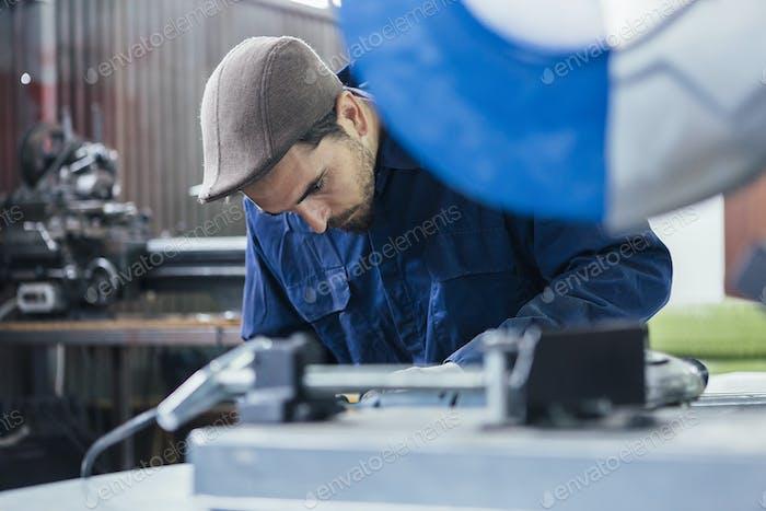 Bearded worker looking down