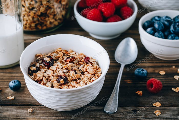 Homemade granola cereal with oats and nuts and dry cranberries.