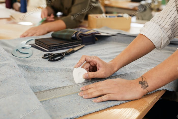 Woman drawing pattern on fabric
