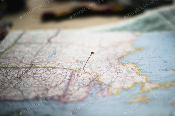 Closeup of pin on the map planning travel journey