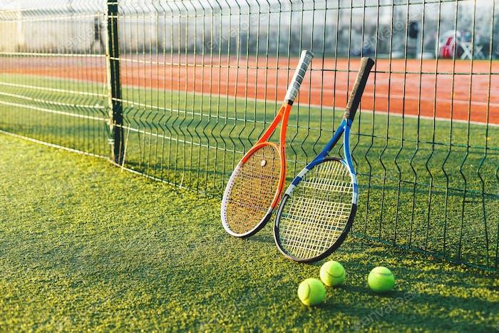 Tennis rackets on grass