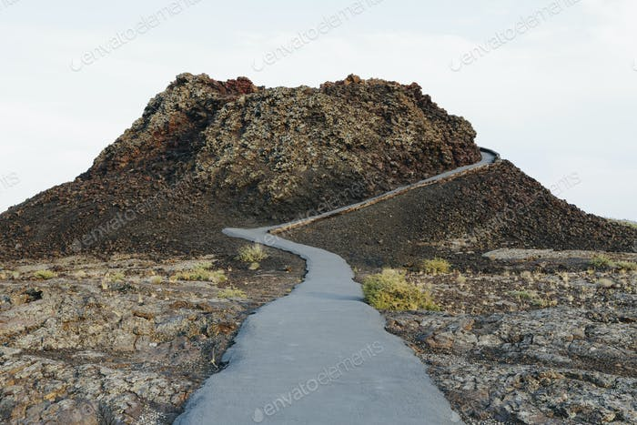 A paved pathway in lava fields