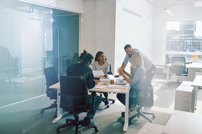 Focused group of business colleagues having an office meeting together