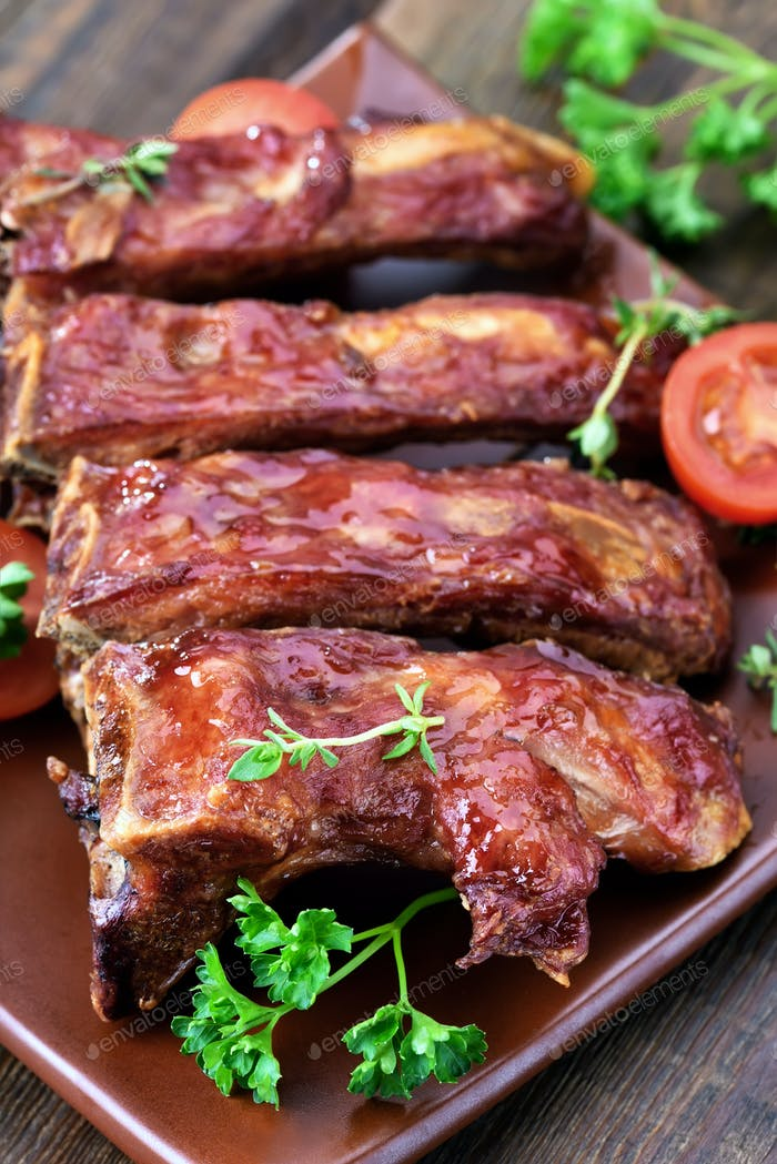 Grilled pork ribs on ceramic plate