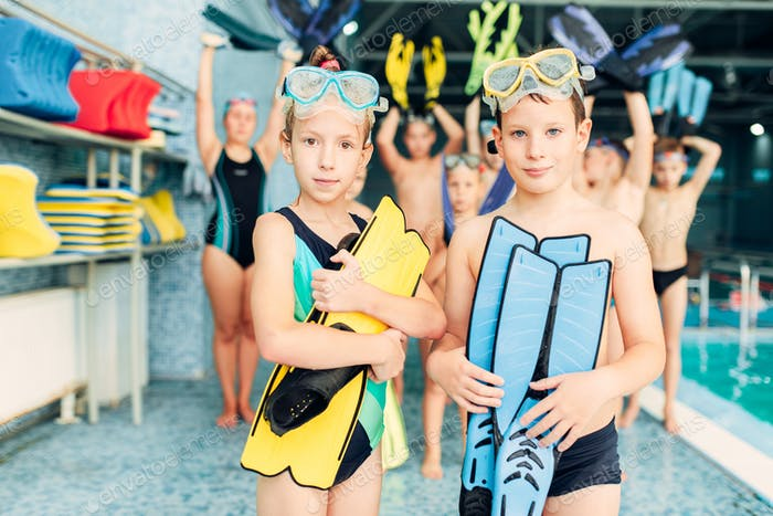 Portrait of boy and girl with colorful flippers