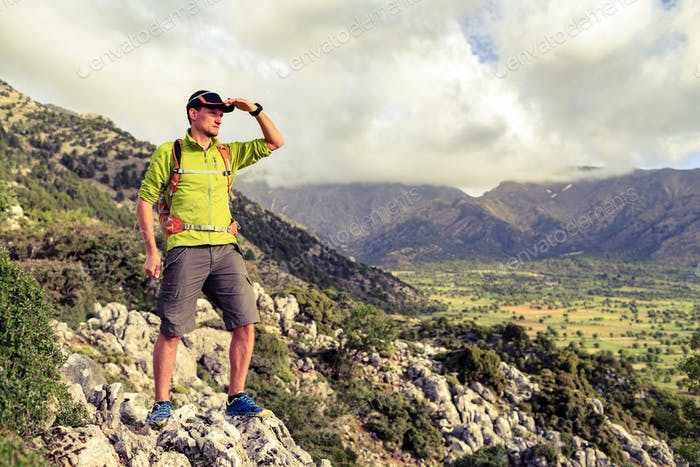Hiking man looking at beautiful inspirational landscape