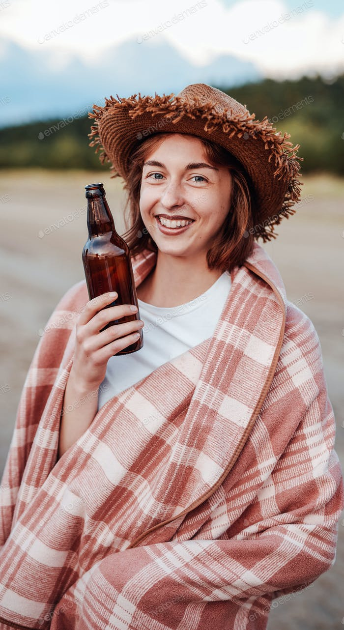 Happy girl with a beer bottle in her hand