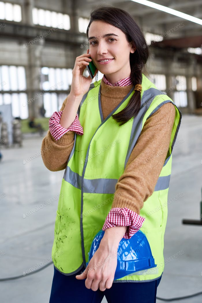 Young Woman  Speaking by Phone at Factory