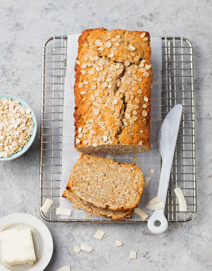 Healthy vegan oat and coconut loaf bread, cake on a cooling rack Top view