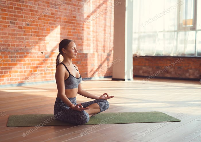 Young girl in yoga class