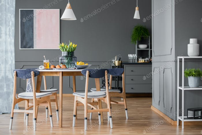 Paint-dipped chairs around table