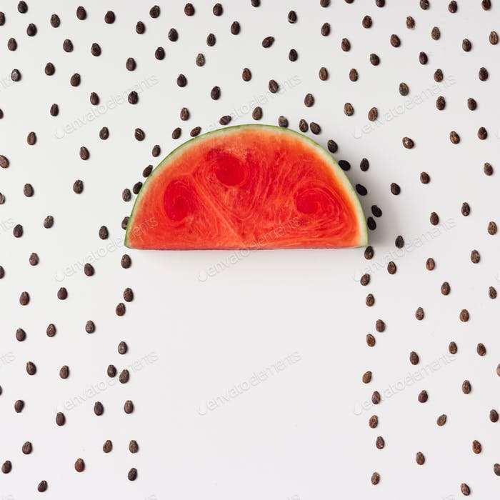 Watermellon slice with seeds raining