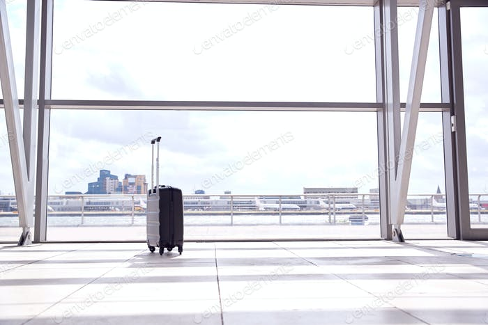 Unattended Suitcase Posing Security Threat In Airport Building