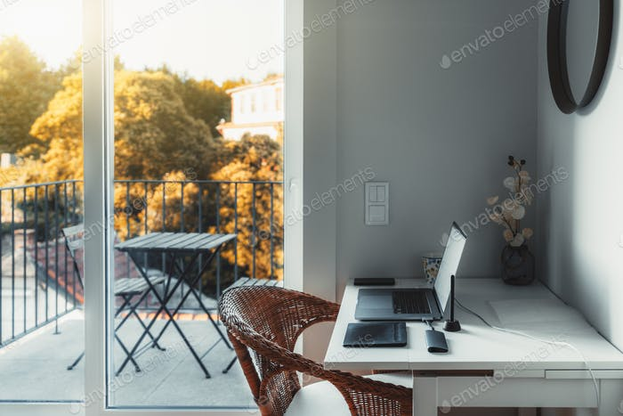 Cozy nook with a desktop and laptop