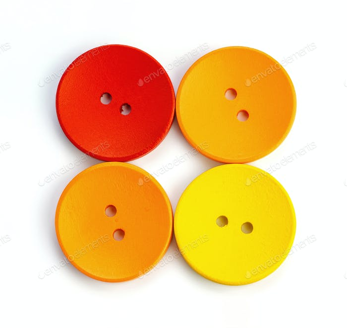 colored wooden buttons on white background